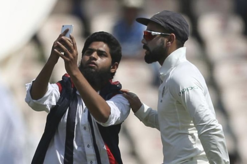 fan-breaches-security-rushes-pitch-click-selfie-virat-kohli