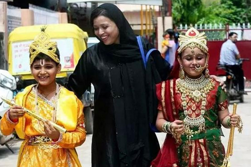 A Muslim woman with her children dressed as Lord Krishna and Radha.