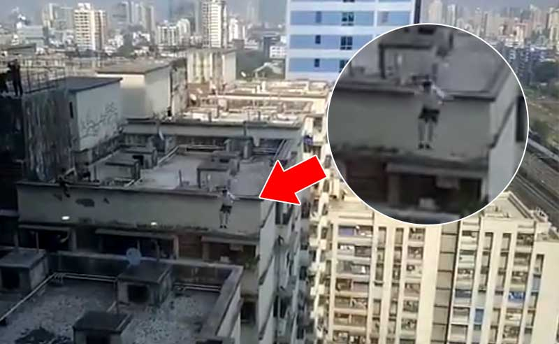 Man Jumps One Building Another