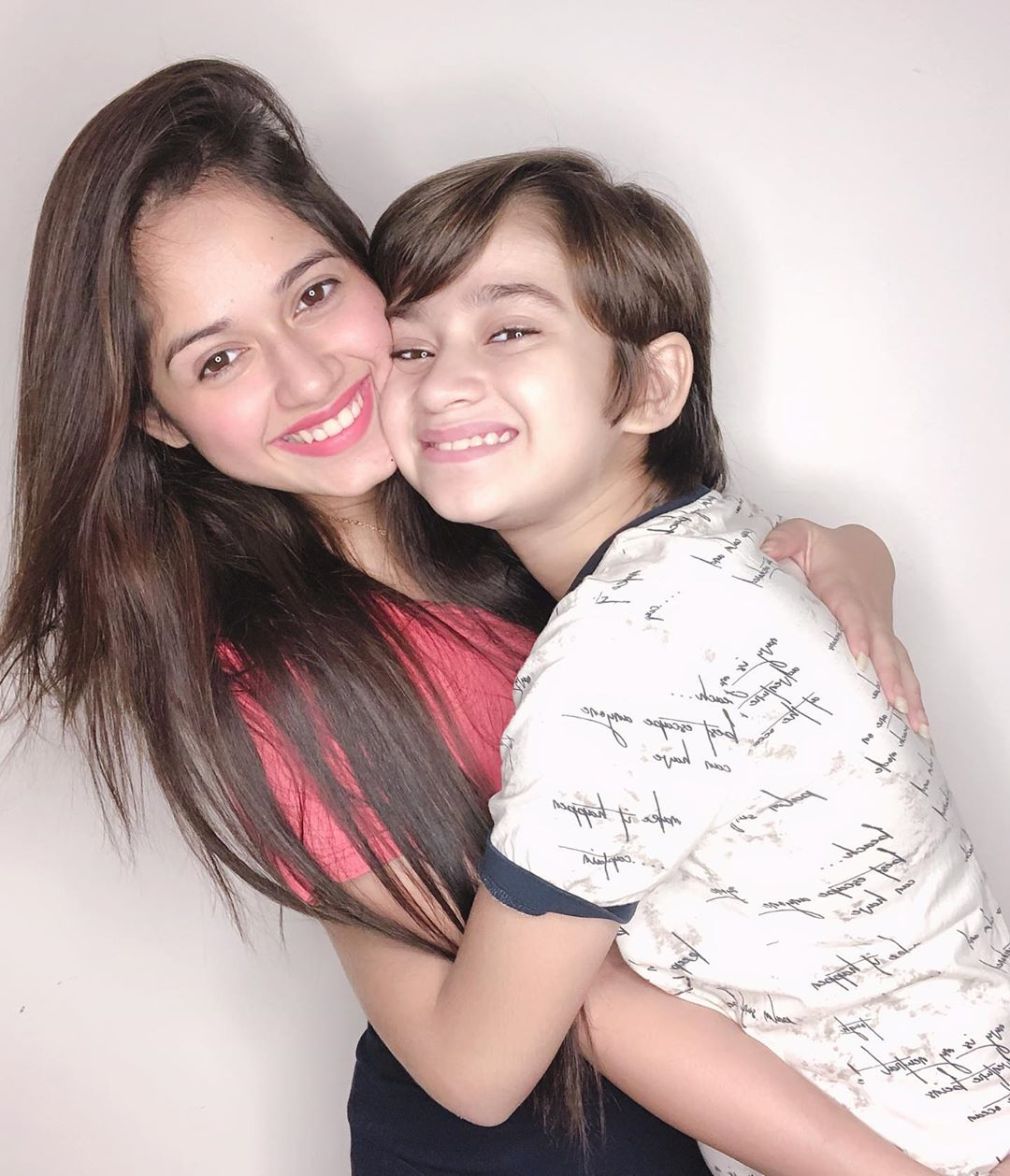 23. Jannat poses with her younger brother